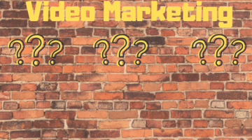 Video Marketing and question marks on a brick background