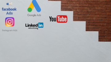 Social ads logos on grey and brick background